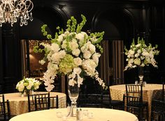 pretty:-) Also, I like the mix of tall and short centerpieces on alternating tables.