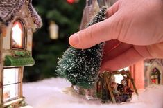 Christmas Village Setup Tips. Christmas villages are a traditional part of Christmas decorating for many people. Fun to collect and beautiful when displayed, they usually feature lit buildings and scenes of people enjoying the holiday season, complete with snow-covered trees, tiny snowmen, and frozen ponds of ice. Set up your Christmas village the...