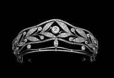 A diamond belle epoque tiara, circa 1900. Formed by two olive branches, with circular diamonds as fruits, in a wreath formation, on a raised band of diamonds. Possibly now part of the Albion Art collection in Japan.