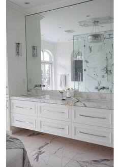 Gorgeous White Marble Bathroom with Mirror Wall