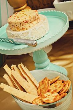 cheese station, cheese buffet, party setup  cute to use a cake stand for the cheese to add dimension to the table