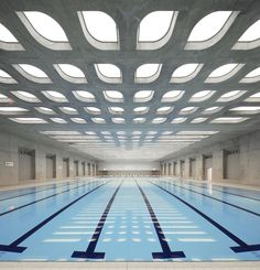 The London Aquatics Center was designed to accommodate 17,500 spectators for the 2012 summer Olympics. It's undulating concrete roof features cutouts that allow natural light to filter in across the pool's blue water.