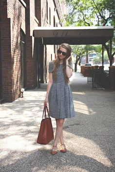 simple grey dress with brown accessories