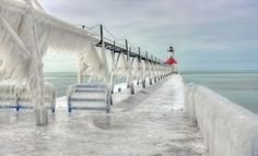 Frozen Lighthouses Caught In Winter's Icy Grip On Lake Michigan Shore Photograhers Thomas Zakowski and Tom Gill