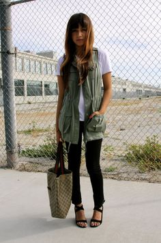 I don't even LIKE safari jackets/vests .. but this look is super cool. I ADORE those CK strap wedges