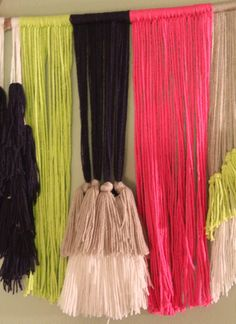 Overview: This retro bold wall hanging would go great in any bedroom, entryway, or office space. Its driftwood foundation is wrapped and knotted by several pieces of yarn made for hanging. Bold and bright colored yarn cascades down from the driftwood to create a flowing tapestry to be