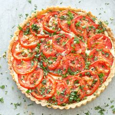 In our Tomato Tart, we developed a simple recipe with a flavorful and foolproof crust, a creamy base, and a topping of fragrant sliced tomatoes.