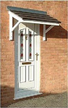 Look at this magnificent solid front doors - what an original design Door Canopy Kits, Over Door Canopy, Front Door Awning, Door Overhang, Porch Awning, Porch Canopy, Diy Awning, Porch Roof, Door Canopy Plans