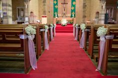 ceremony decor and pew ends of baby's breath