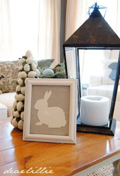 Easter decor. I like the idea of having one frame and rotating out pictures for each holiday! Save so much time and space!