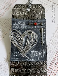 Barbara shows off some fun techniques on this metallic Tim Holtz tag! Check out her blog and get the full scoop.
