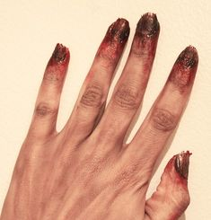 glue + cotton + polish and paint MUST not forget nails. Zombies don't get manicures.