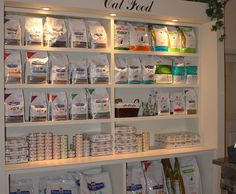 Veterinary clinic reception - Google Search - I like that the shelving & spaces between shelves are proportionate to the products being sold
