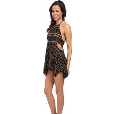Free People Open Side Print Romper- Black Size L BRAND SPANKING NEW- Free People Open Side Romper- Black Print- High round neckline with low cut back.- Adjustable tie at back neck. Button loop panel at back.- Draped, handkerchief hemline in front with straight hemline in back.- 100% rayon;Trim: 100% nylon. Hand wash cold, dry flat. Imported, Retail $98.00 Free People Pants Jumpsuits & Rompers