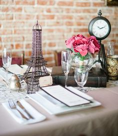 An assortment of on-theme trinkets—a decorative Eiffel Tower, a miniature tea pot, a freestanding clock—will add a romantic and elegant touch to the table.
