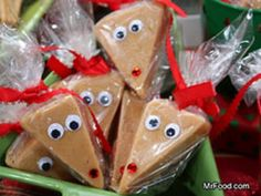 Cut peanut butter fudge, blonde brownies, rice krispie treats, etc. into triangles and decorate as reindeer.