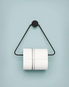 Ferm Living Black Toilet Paper Holder is both beautiful and functional – the perfect accessory for any bathroom. The black stained oak and black metal give the toilet paper holder a timeless look.