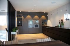 Hamran Kitchen. Extraordinary kitchens from Norway. Kitchen inspiration. Scandinavian design. Lacquered mdf high cabinets. Smoked oak cabinets With Integrated pulls in drawers. Dark Kitchen. Gaggenau appliances. Open shelves.