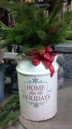 Holiday expression applied to painted milk can