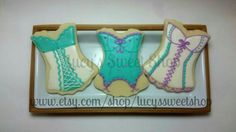Lingerie Cookies - Corsets, undies, bras, lips, and mens chests cookies perfect for bachelorette, birthday parties, bridal showers, & more by Lucy's Sweet Shop at www.facebook.com/lucyssweetshopneptunebeach  Teal and purple sexy corset cookies