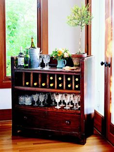 Storage Bar - Reconsider beat-up flea market finds like this old dresser. By removing a few drawers and restaining the piece, it was transformed into the perfect mini-bar Oooh, I'm kinda likin this idea!