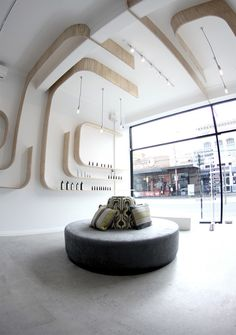 'vitality hub' by alexander watkins  image ©blake sanders    Beautiful design and execution of an alternative medicine clinic with retail displays.