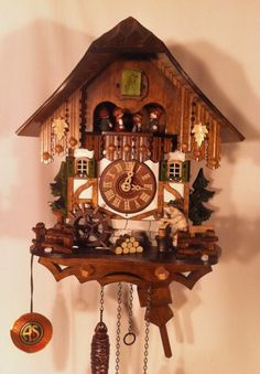 Musical Quartz Chalet Cuckoo Clock with Animated Wood-chopper, Dancers and Water-wheel.