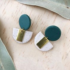 LOLA Earrings - Clay and brass earrings - Speckled sand with a large eucalyptus green stud A bold pair of statement earrings in eucalyptus green and speckled sand with raw brass. Polymer Clay Crafts, Polymer Clay Jewelry, Handmade Accessories, Handmade Jewelry, Diy Clay Earrings, Metal Clay Jewelry, Bijoux Diy, Clay Charms, Messing