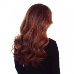 Long healthy brunette hair with a soft highlight and sexy wave.