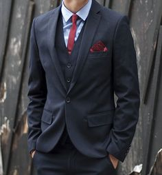 Classic navy 3 piece suits with red accent.