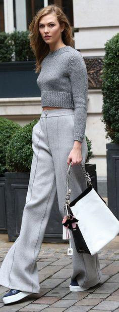 Who made Karlie Kloss' platform shoes, gray wide leg pants, cropped sweater, and white handbag?