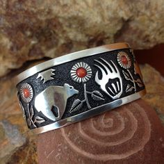 This highly detailed Sterling Silver Cuff Bracelet features a Bear design with Red Coral on an oxidized background. Colors may vary by computer monitor. They are designed and made by Philbert Begay, N