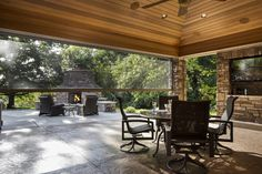 Outdoor patio living room. Great for entertaining with a brick fireplace, flat screen tv, built-in girll/kitchen and automatic screened walls
