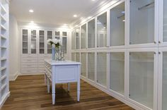 closet love...love all the white shelving...would have darker floors and a mirrored table console