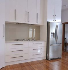 Výsledek obrázku pro modern white kitchen with glass on the wall