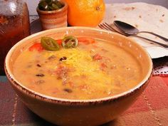 Mexican Cheeseburger Soup Ingredients: 1 1/2 lbs lean ground beef 2 garlic cloves, crushed 1 cup chopped onion 1/4 cup chopped red bell pepper 1 (28 ounce) diced tomatoes, undrained 1 (4 ounce) can...
