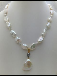 Necklace featuring Fresh Water Keshi Pearls and Tahitian Pearls Yellow Gold Beads and Clasp