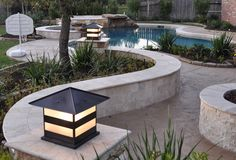 Our post lanterns blend well with the beautiful landscaping.
