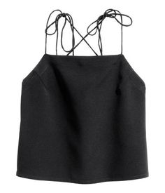 Black. Sleeveless top in woven fabric with a low-cut back. Narrow shoulder straps crossed at back.