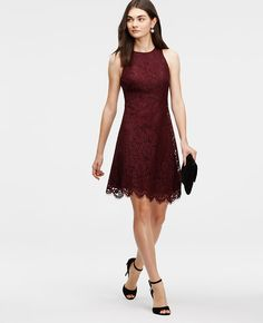 "Best lace scenario: luxe lace - and an exquisitely scalloped hem - elevates this femme flare into a modern masterpiece. Jewel neck. Sleeveless. Hidden back zipper with hook-and-eye closure. Lined. 21"" from natural waist."