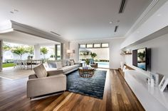 Spotted Gum Floors - Grey / White walls / Light fabric couch / Floating white / timber TV Unit