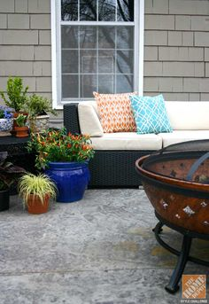 Outdoor sofa with fire pit and container gardens on a deck after a patio makeover