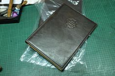 Dominique Saint Paul. Custom made menu covers - hand coloured crust leather.