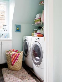 Because you can't afford to waste a sliver of space in a small laundry room, take storage as high as you can with custom shelving.