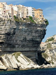 Bonifacio - cliff-top city in Sardinia, Italy.  I think I would feel insecure in one of those buildings!