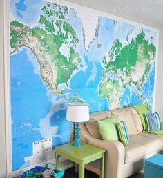 "Giant ""framed"" world map. The map was stapled & taped with double sided tape and then they surrounded it with white painted molding. Love this idea for a play room. So bright and fresh."