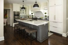 Martha O'Hara Interiors: Two-tone kitchen with white kitchen cabinets paired with black granite perimeter ...