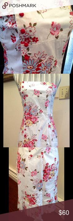 ruth Strapless rose and daisy floral dress Cotton button up pretty floral dress by ruth. Size 6. Bust is 32 inches, waist is 28, hips are 38 inches. NWT. Covered buttons are red. Ethereal and romantic dress! ruth Dresses Strapless