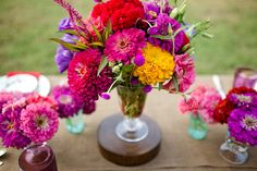 Beautiful bouquets are always a great place to pull wedding color palettes from! The colors in this bouquet would be stunning for a winter wedding. Red Wedding Flowers, Floral Wedding, Wedding Colors, Orange Wedding, Deco Floral, Arte Floral, Flower Centerpieces, Wedding Centerpieces, Centerpiece Ideas