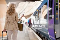 Stock Photo : Female traveller uses computer tablet at railway